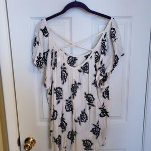 White a black floral blouse
